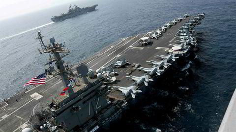 Dersom USA bruker militærmakt mot Iran, vil det få alvorlige følger for oljeprisen, advarer en av ayatolla Ali Khameneis nære rådgivere.