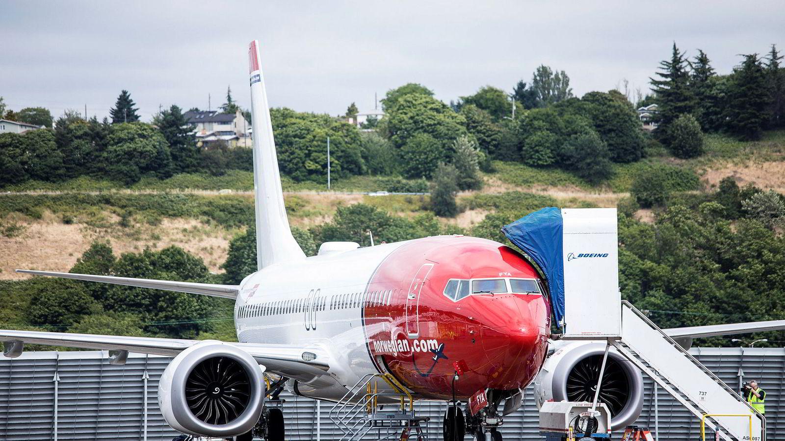 Et av Norwegians Boeing 737 Max-fly fotografert på Boeing-fabrikken i Seattle – før det ble levert til selskapet i 2017. Parkerte fly fører til store ekstrakostnader denne sommeren.