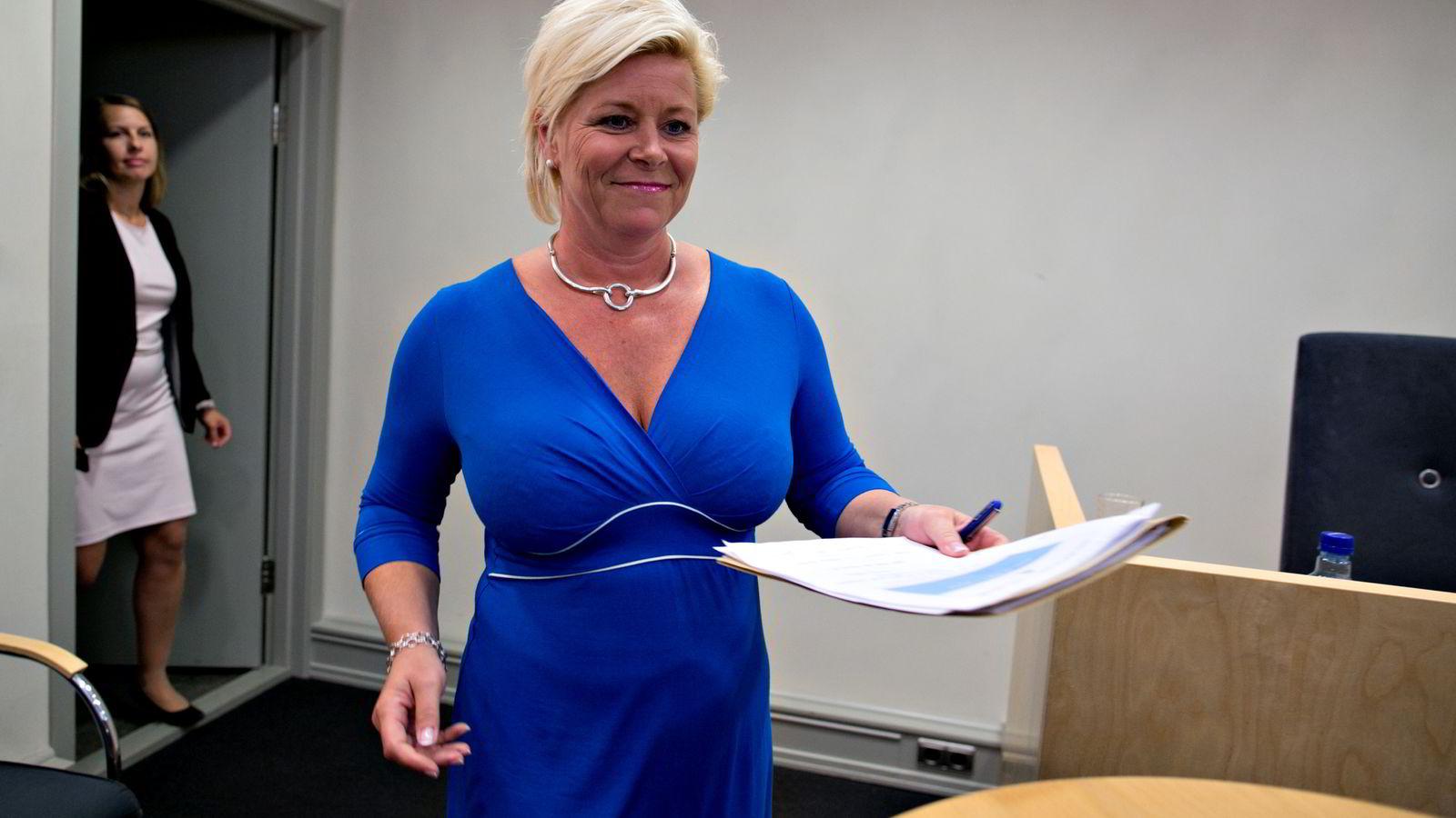 Finansminister Siv Jensen (Frp) holder pressekonferanse i Finansdepartementet om endringene i skatte- og avgiftsforvaltningen. Foto: Anette Karlsen /