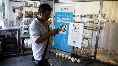 Kinas to største internettselskaper har kapret markedet for betalingstjenester. Ant Financial og Alipay-tjenesten er blitt verdens mest verdifulle finansteknologiselskap på tre år. Selskapet er sannsynligvis verdt like mye som den amerikanske finansinstitusjonen Goldman Sachs. Foto: Wang Zhao/AFP/NTB Scanpix