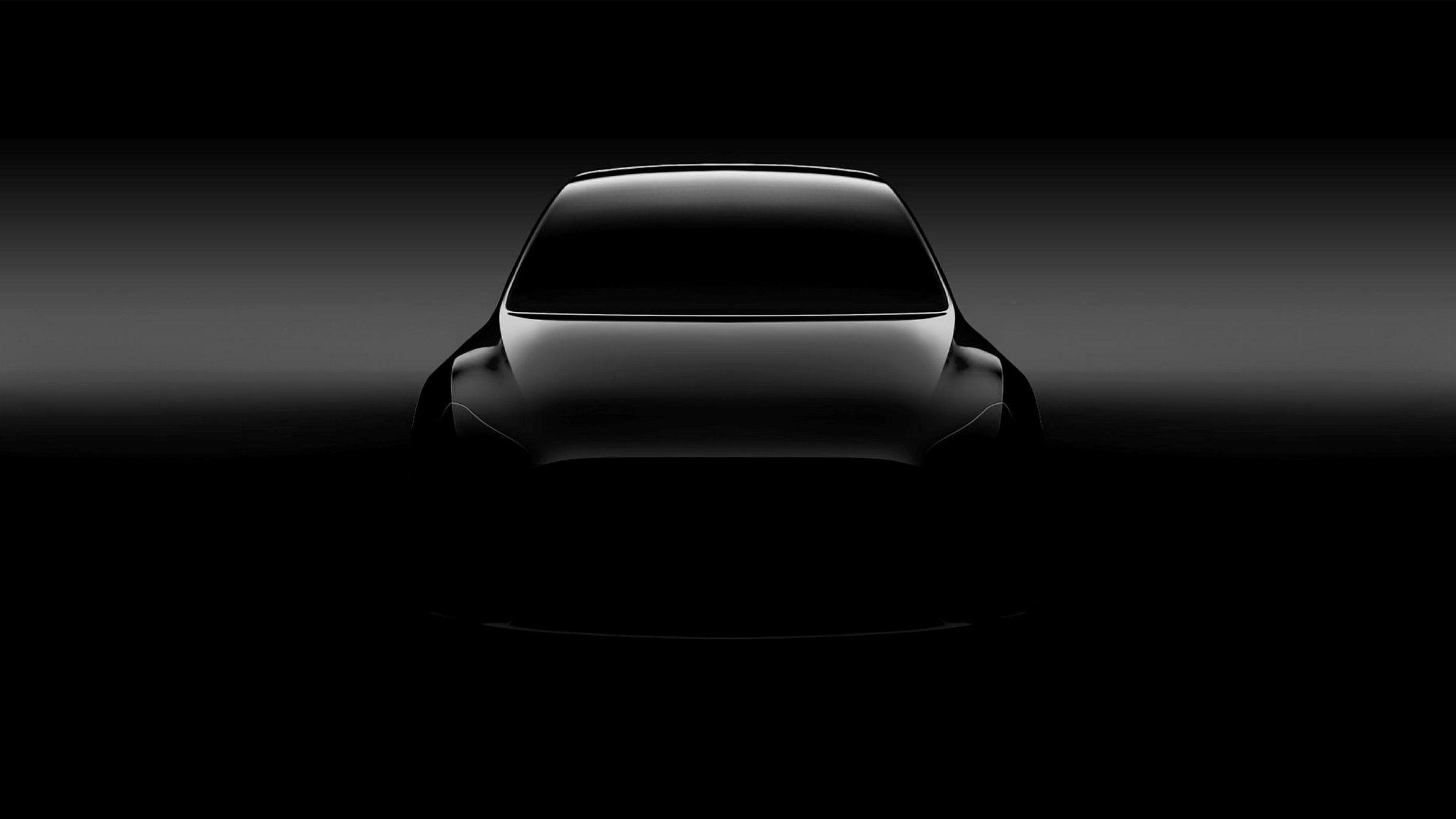 Det første bildet av Tesla Model Y avslører ikke så mye annet enn at den mangler sidespeil og at formen minner om Teslas øvrige modeller.