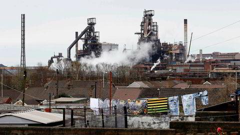 Stålfusjonen tas i mot med behersket optimisme ved Tata Steels stålverk i Port Talbot i Wales.