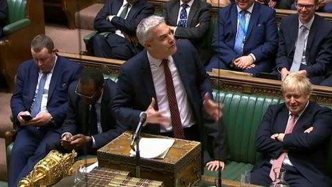 Brexitminister Stephen Barclay og statsminister Boris Johnson da Underhuset vedtok brexitloven.