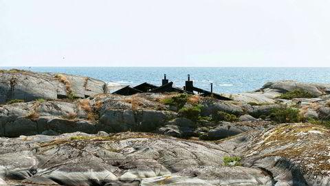 Village People. Hyttene ble bygget over flere år, og ligger som en liten landsby i havgapet.