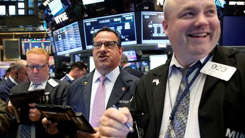 Stemningen har vært god i det amerikanske aksjemarkedet de siste månedene. I august steg alle de tre sentrale aksjeindeksene til de høyeste nivåene noensinne. Foto: REUTERS/Brendan McDermid/NTB SCANPIX.