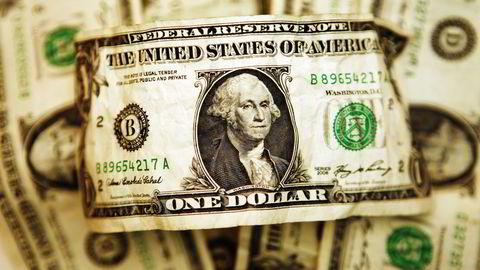 Dollaren ble svekket på bred basis onsdag kveld etter at den amerikanske sentralbanken Federal Reserve varslet lavere tempo i den videre rentesettingen. Foto: Mark Blinch/REUTERS/NTB SCANPIX