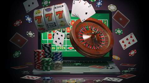 Online casino concept. Laptop with roulette, slot machine, casino chips and playing cards isolated on black background. 3d illustration ---
