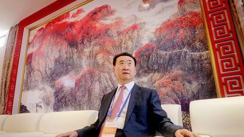 RIKEST. Wang Jianlin er Kinas rikeste person, og har bygd opp formuen fra eiendom. Mye tyder på at han nå vil være med å godkjenne forslag som kan ramme hans eget selskap. Foto: Jason Lee, Reuters/NTB Scanpix