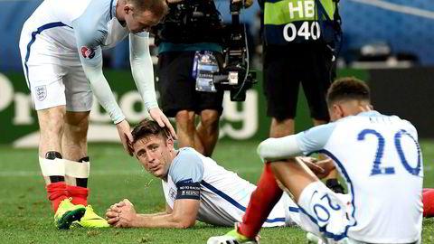 Wayne Rooney, Gary Cahill og Dele Alli depper etter Englands tap mot Island. I tillegg til England hadde Storbritannia med Nord-Irland og Wales til EM. Foto: Anne-Christine Poujoulat/AP/NTB Scanpix.