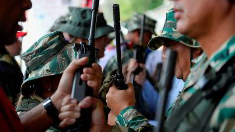 Sikkerhetsstyrker i Venezuela hevdes å ha drept ungen menn i fattige nabolag.
