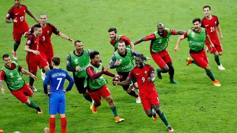 Portugal's Eder, front right, celebrates after scoring the opening goal during the Euro 2016 final soccer match between Portugal and France at the Stade de France in Saint-Denis, north of Paris, Sunday, July 10, 2016. (AP Photo/Michael Sohn)