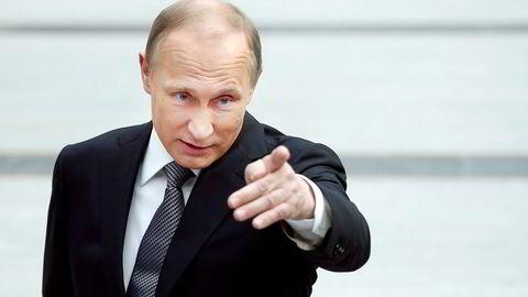 Russlands president Vladimir Putin har blitt kastet ut av banken. Foto: Maxim Shemetov/Reuters/NTB Scanpix
