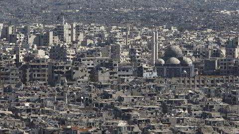 Borgerkrigen i Syria har lagt store deler av byen Homs i ruiner. Foto: Reuters / NTB scanpix