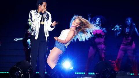 Strømmetjenesten Tidal eies av Jay Z (til venstre), sammen med blant andre kona Beyoncé, og en rekke andre superstjerner.