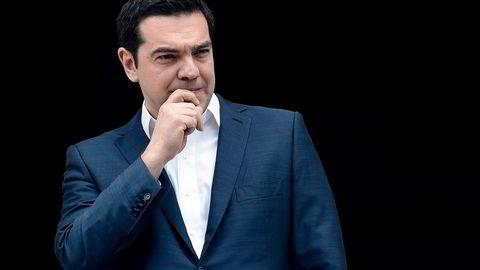 Statsministeren Aleksis Tsipras og Hellas står igjen i fare for å falle ut av eurosamarbeidet. Foto: Aris Messinis/AFP/NTB Scanpix