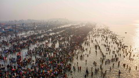 TOPSHOT – In this aerial photo taken on January 14, 2020, Hindu devoteks gather to take a holy dipp in the Bay of Bengal during the Gangasagar Mela, at Sagar Island, some 150 kilometers south of Kolkata. (Photo by XAVIER GALIANA / AFP) ---