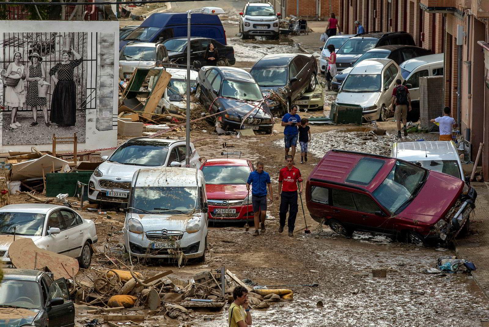 En brå og uventet flom i elven Cidacos oversvømmet byen Tafalla i Navarra-provinsen i Spania i begynnelsen av juli. Vannmassen etterlot seg et kaos av ødelagte gater, bygninger og biler.