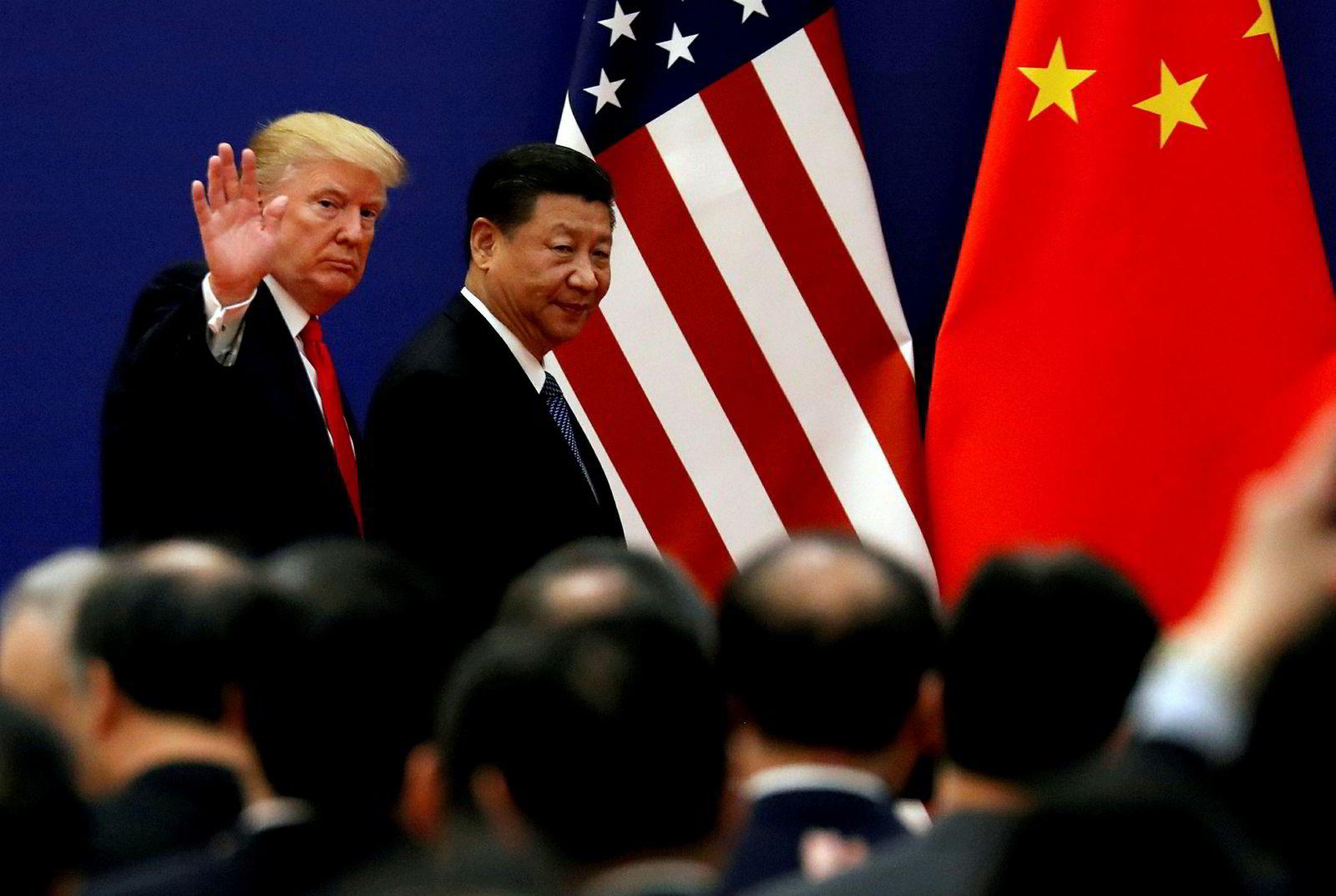 USA og Kina er i full handelskrig. Begge landene har mangedoblet tollen på det andre landets varer, og forsøk på forhandlinger har så langt ikke ført fram. Bildet er av de to presidentene Donald Trump og Xi Jinping under et møte i 2017.