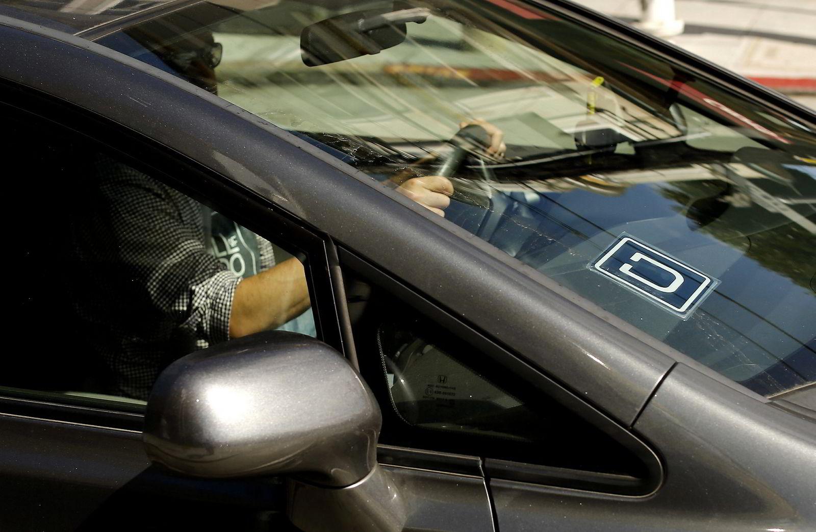 Over 60 Uber-sjåfører er til nå avskiltet i Norge. Foto: Robert Galbraith/Reuters/NTB Scanpix