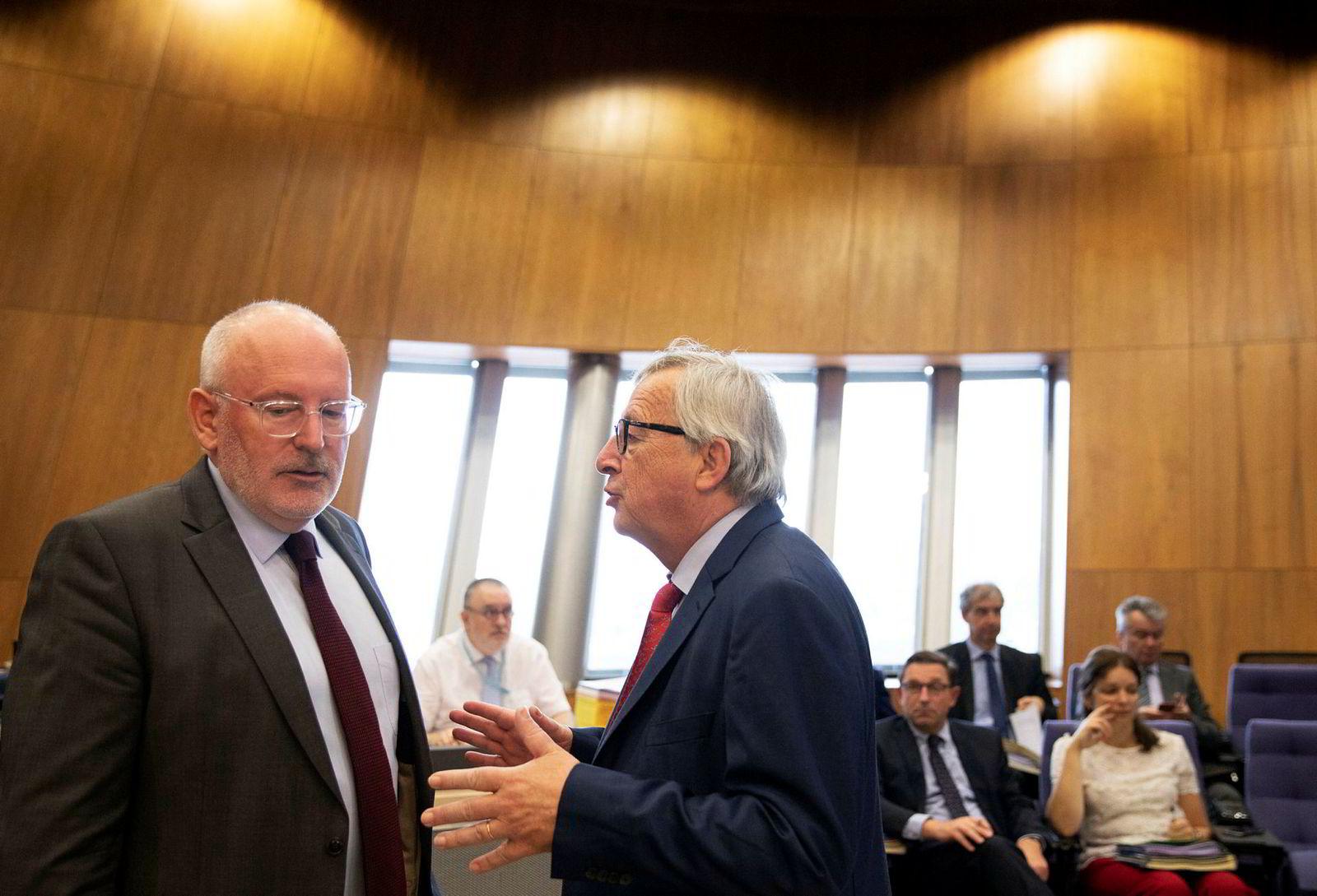 Frans Timmermans (til venstre) er favoritt til å overta som president i Europakommisjonen etter Jean-Claude Juncker.