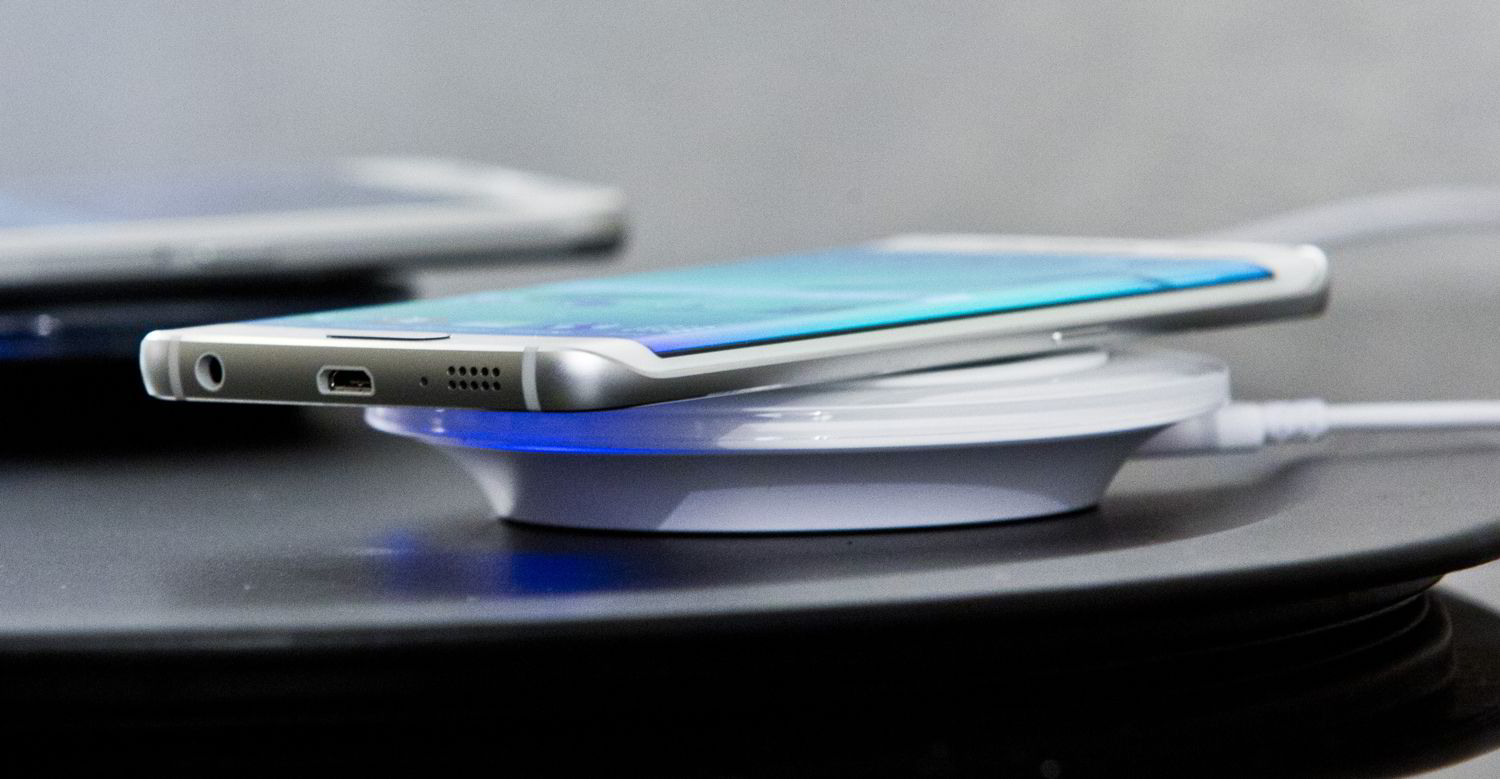 One of two new Samsung phone, Galaxy S6 Edge, is shown on a wireless charger at a special press preview, Monday, Feb. 23, 2015, in New York. (AP Photo/Bebeto Matthews)