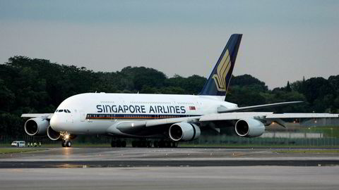 Et Airbus A380-fly fra Singapore airlines lander ved Changi flyplass i Singapore. Foto: AP / NTB scanpix