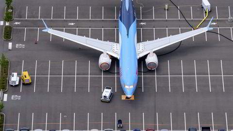 Boeing-aksjen var blant børsvinnerne mandag, etter at nye vaksinenyheter løftet troen på retur til reiseliv. Her en av mange parkerte Boeing 737 Max, her fra Seattle i USA.