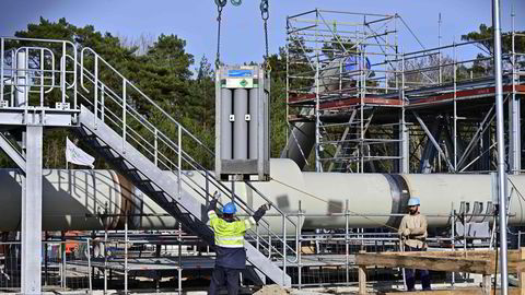 Men working at the construction site of the so-called Nord Stream 2 gas pipeline in Lubmin, northeastern Germany, on March 26, 2019.