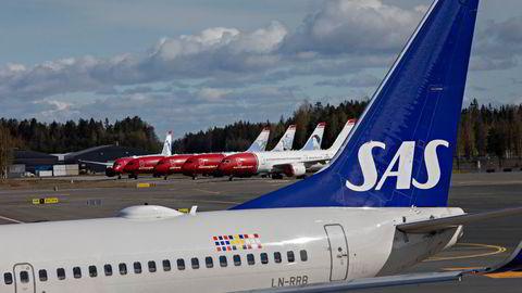 SAS er holdt i live gjennom pandemien ved hjelp av støtte fra sine statlige eiere i Sverige og Danmark – og en lånegaranti fra den norske stat. Her fra Oslo Lufthavn.
