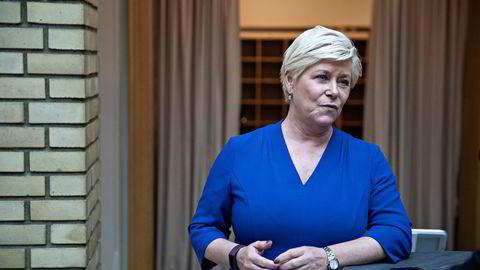 Frp-leder Siv Jensen avbildet etter at finansminister Jan Tore Sanner (H) la frem statsbudsjettet for 2021 i høst.