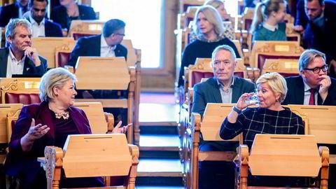 Statsminister Erna Solberg og finansminister Siv Jensen (Frp) i Stortinget før fremleggelsen av regjeringens forslag til statsbudsjett for 2020. Bildet er fra i fjor.