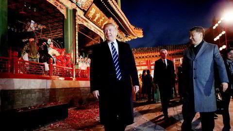 USAs president ble tatt godt imot av Kinas president Xi Jinping i Beijing onsdag. Her kommer de ut fra en operaforestilling i Den forbudte by samme kveld.