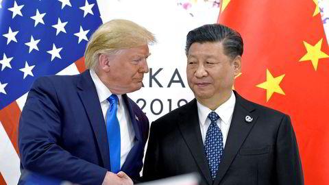 USAs president Donald Trump sammen med sin kinesiske motpart Xi Jinping i fjor sommer. Kina håper Trump taper valget, ifølge amerikansk etterretning.