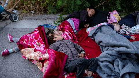 Children sleep on the road near the fire-destroyed Moria refugee and migrant camp on the island of Lesbos, Greece, Thursday, Sept. 10, 2020. A second fire in Greece's notoriously overcrowded Moria refugee camp destroyed nearly everything leaving thousands more people in need of emergency housing. (AP Photo/Petros Giannakouris) ---