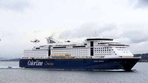 Regjeringen vil la Colors Oslo-Kiel-ferger flytte til NIS-registeret og spare på å ansette hotell- og butikkbetjening på utenlandske vilkår