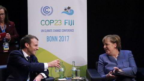 Frankrikes president Emmanuel Macron og Tysklands statsminister under klimatoppmøtet i Bonn i Tyskland. Foto: Oliver Berg / AP / NTB scanpix
