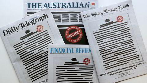 En rekke aviser i Australia hadde en sensurert forside mandag i forbindelse med en kampanje om hemmelighold fra myndighetene som de begrunner med sikkerhetsmessige årsaker. Foto: AP / NTB scanpix