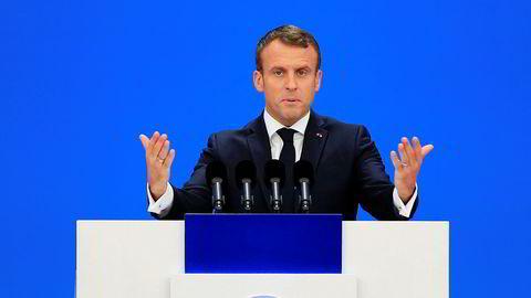 Frankrikes president Emmanuel Macron beklager at USA trekker seg fra Parisavtalen.