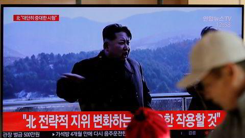 Tv i Sør-Kore kunngjør rakettesten med opptak av Nord-Koreas leder Kim Jong Un.