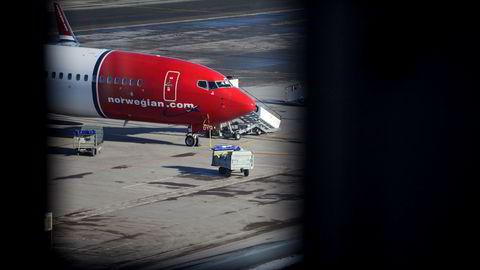 Et Norwegian-fly på Oslo Lufthavn. Det var ombord på et Norwegian-fly på flyplassen Gatwick at krangelen mellom passasjeren og flypersonalet skal ha oppstått.