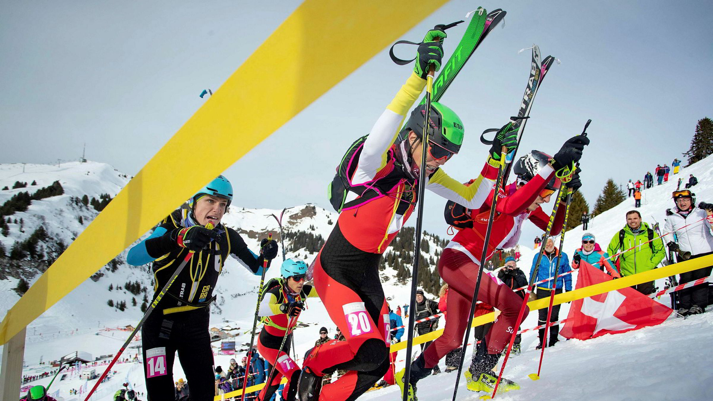 In this handout photo released by the Olympic Information Services (OIS) of the International Olympic Committee (IOC) shows Ot Ferrer Martinez of Spain (20), Thomas Bussard of Switzerland (R), Nikita Philippov of Russia (14), and Marc Radua Ivern of spain (7) compete in the Ski Mountaineering Men's Sprint Semifinal 2, at the Villars Winter Park on January 13, 2020 during the Winter Youth Olympic Games of Lausanne. (Photo by Chloe KNOTT / OIS/IOC / AFP) / RESTRICTED TO EDITORIAL USE - MANDATORY CREDIT