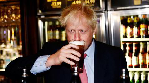 UK's supply of food-grade CO2, a byproduct of ammonia production, is critical to sectors from beer and soft drinks to food packaging and meat. Boris Johnson, the U.K. Prime Minister, drinks beer from a pint glass during a campaign tour, in London in 2019.