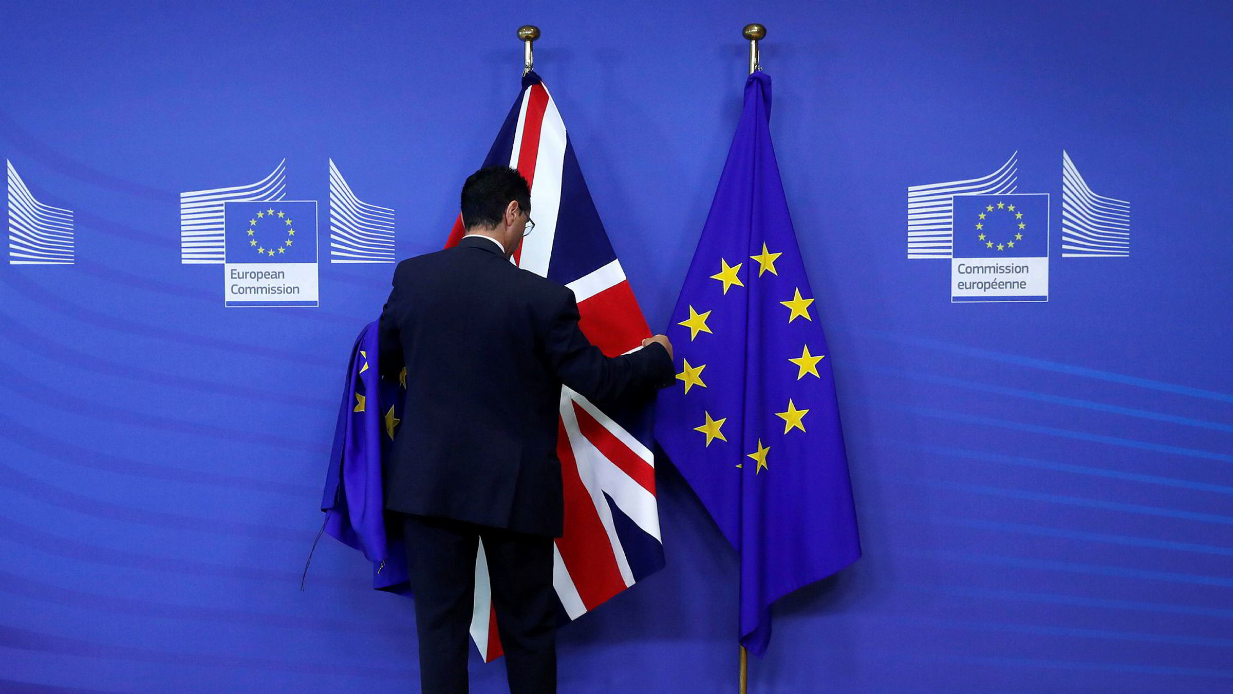 Flags are arranged at the EU Commission headquarters ahead of a first full round of talks on Brexit, Britain's divorce terms from the European Union, in Brussels, Belgium July 17, 2017. REUTERS/Yves Herman ---