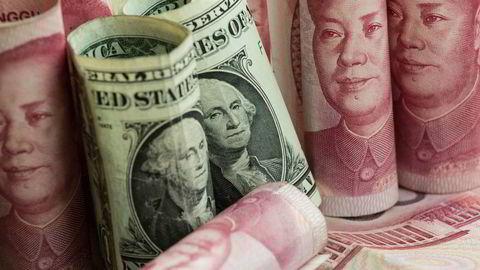 Det var forventet at den kinesiske valutaen ville svekke seg etter årsskiftet. Sentralbanken vil det annerledes og det har skapt panikk på valutamarkedet og rekordhøye renter i offshoremarkedet for den kinesiske valutaen i Hong Kong