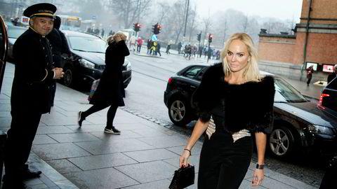 Fredriksens datter, Kathrine Astrup Fredriksen, hastet inn på restauranten og ønsket ikke å prate med DN.