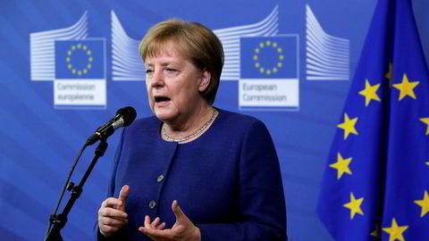 Tysklands statsminister Angela Merkel er under kraftig press om dagen.