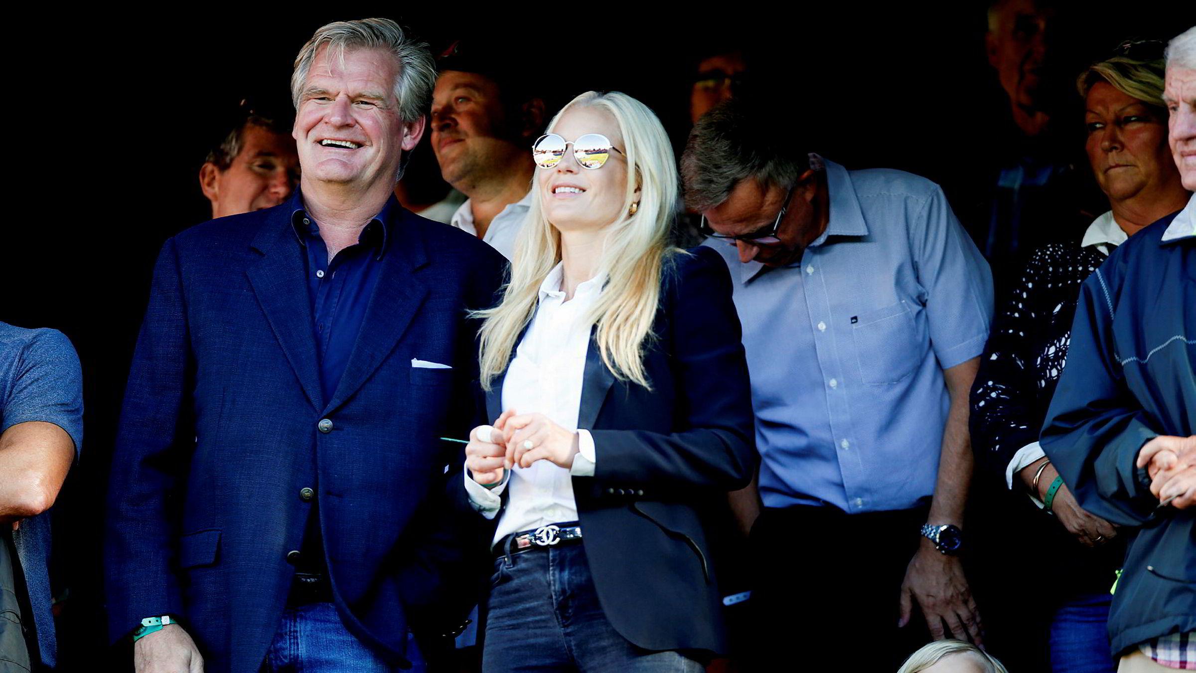 Storebrands kursoppgang bidratt til enda større formue for Tor Olav Trøim og Celina Midelfart. Her er de to på fotballkamp mellom Vålerenga og Brann i fjor.