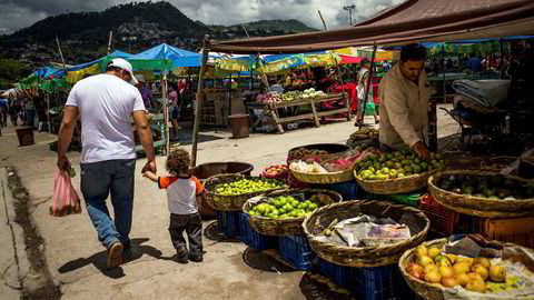 People shop at an open-air market in Tegucigalpa, the capital of Honduras. ---