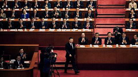 Den kinesiske folkekongressen ble avsluttet tirsdag og president Xi Jinping (i midten) er mektigere enn noensinne.