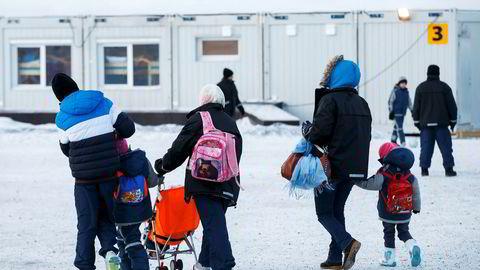 Asylsøkere ved ankomstsenteret for flyktninger i Kirkenes, etter at de hadde krysset grensen til Russland ved Storskog.